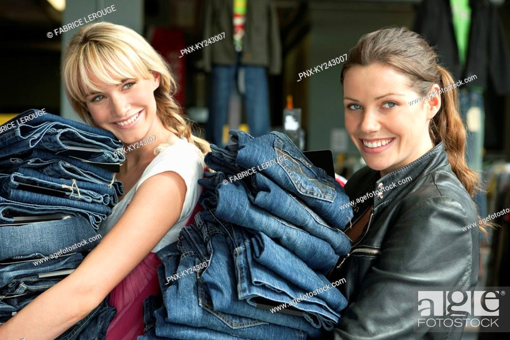 Stock Photo: Women choosing dresses in a boutique.
