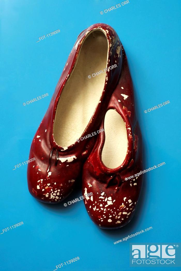 Stock Photo: Red ceramic slippers.