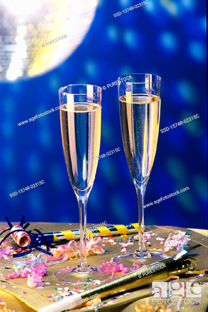 Stock Photo: Close-up of two champagne flutes on a table.