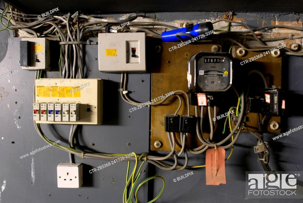 old electrical installation with switch box, meter and fuse box