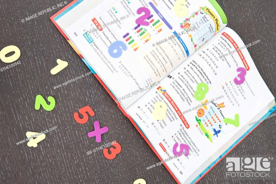 Stock Photo: text book and numbers.
