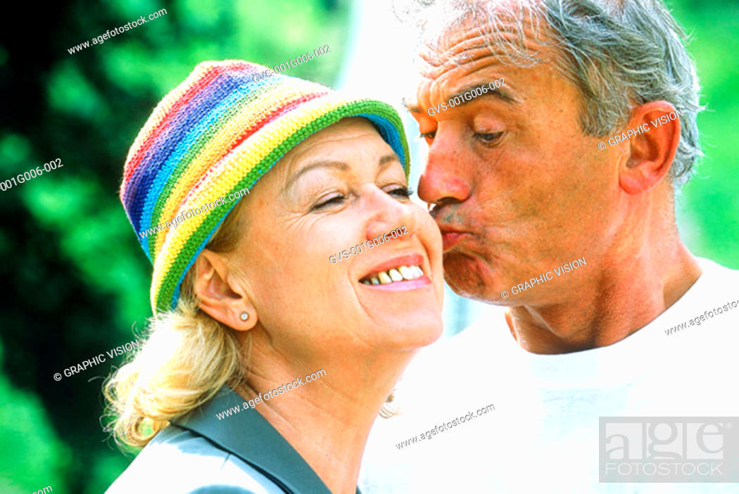Stock Photo: Close-up of an elderly man kissing a woman on the cheek.