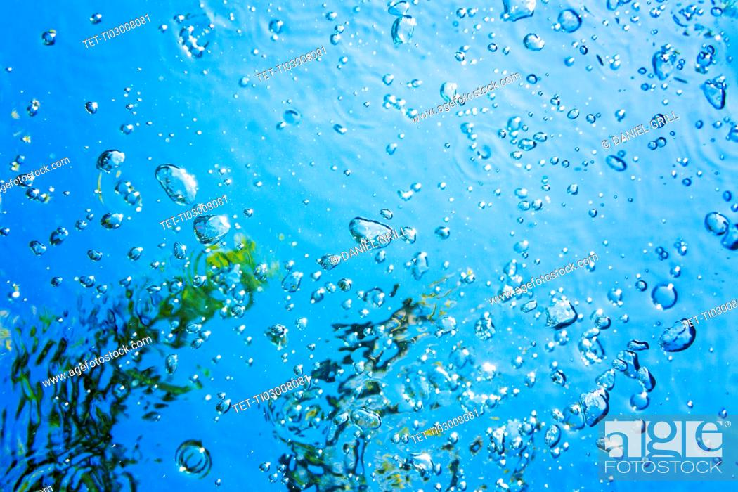 Stock Photo: Bubbles on blue water.