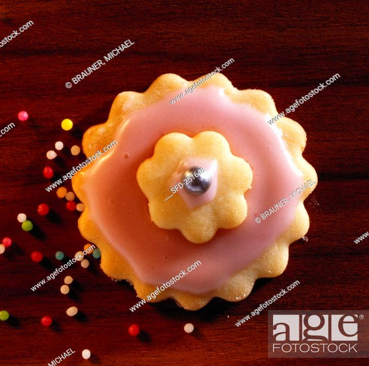 A pink sweet pastry flower with sugar pearls, Stock Photo