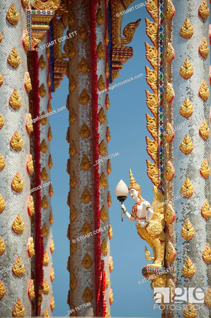Stock Photo: ornate temple pillars, prachuap kiri khan prachuap province thailand.