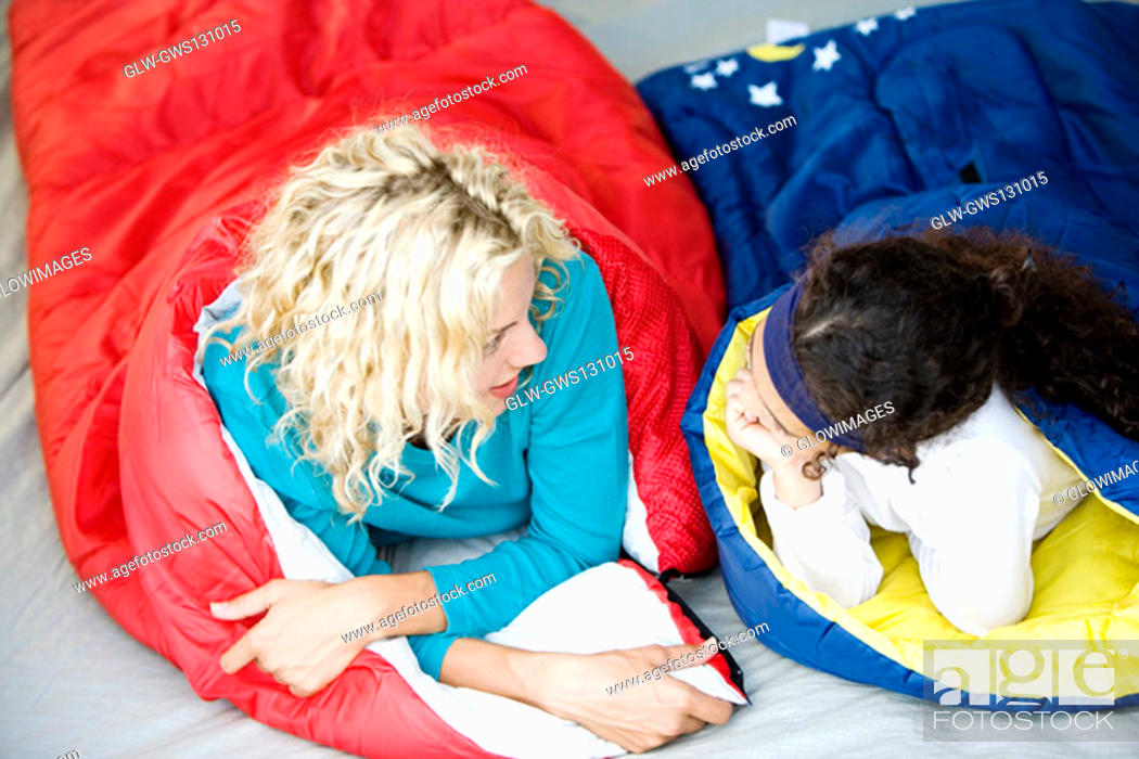 Stock Photo: Mother and her daughter lying in sleeping bags.