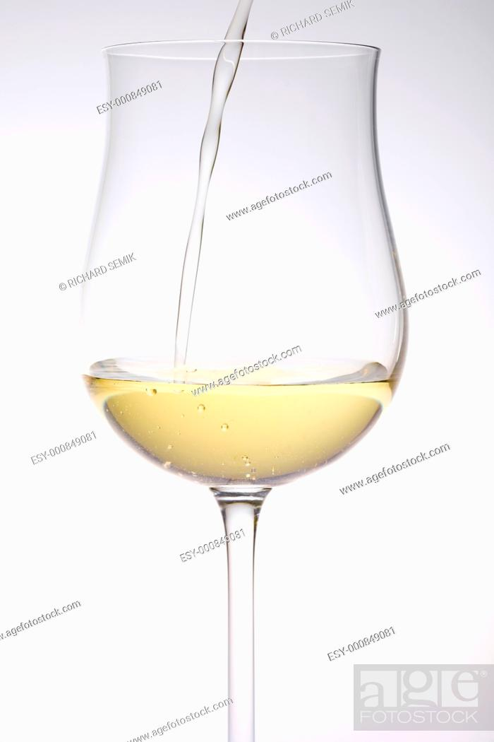 Stock Photo: wineglass with white wine.