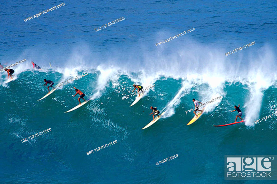 Stock Photo: High angle view of a group of people surfing in the sea.