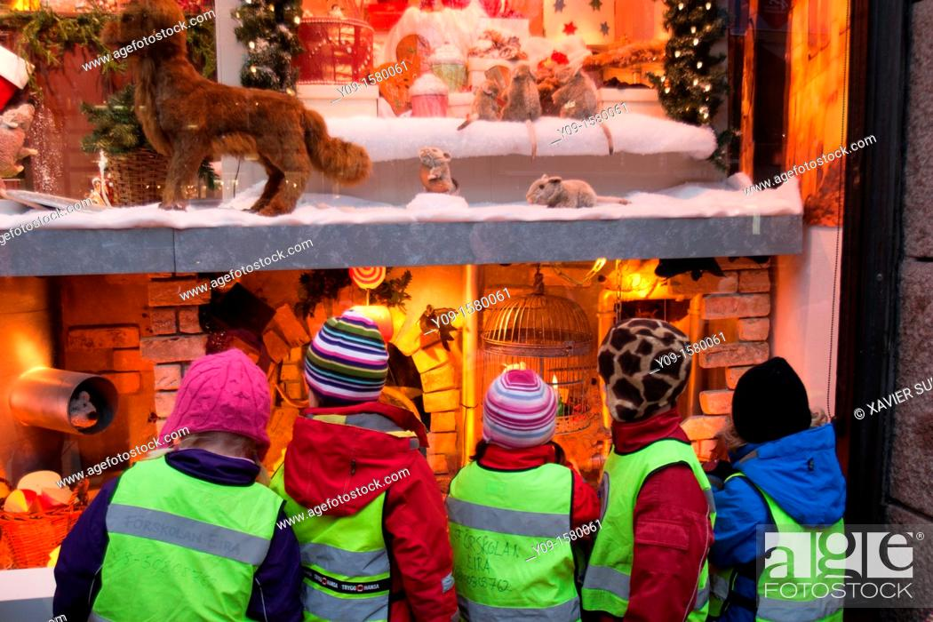 Stock Photo: Children looking at the window of Christmas, Stockholm, Sweden.
