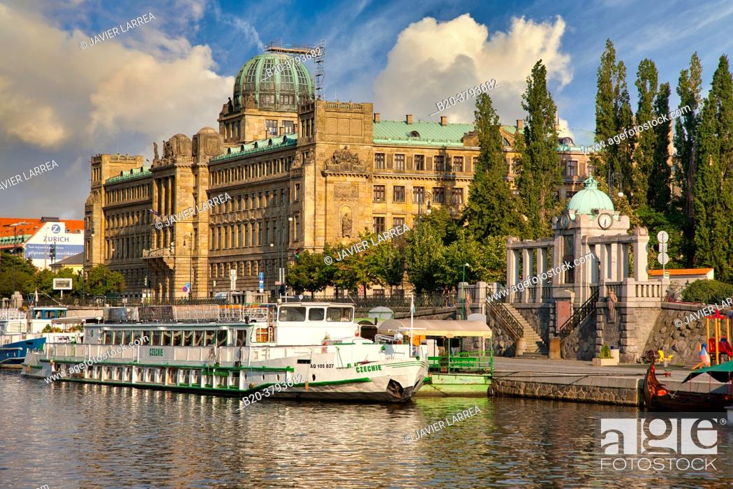 Stock Photo: Ministry of Industry and Trade building and tourboats on Moldau river, Prague, Czech Republic, Europe.
