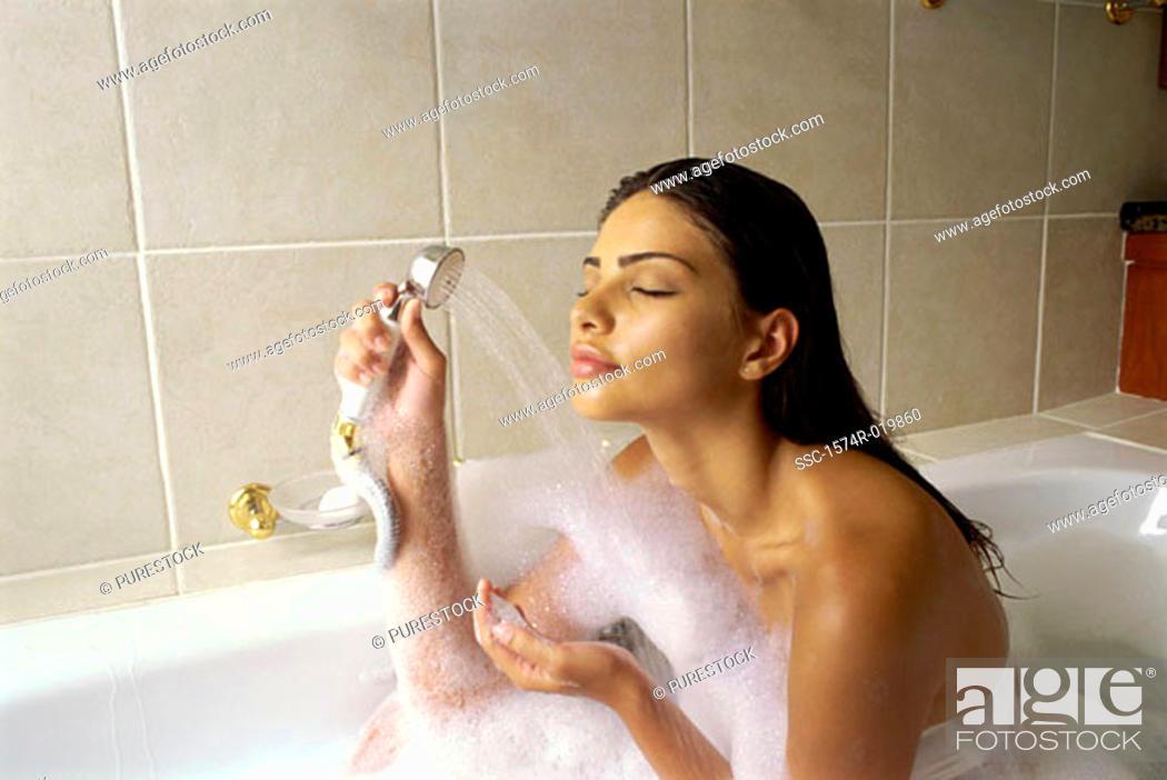 Stock Photo: Young woman taking a bubble bath.