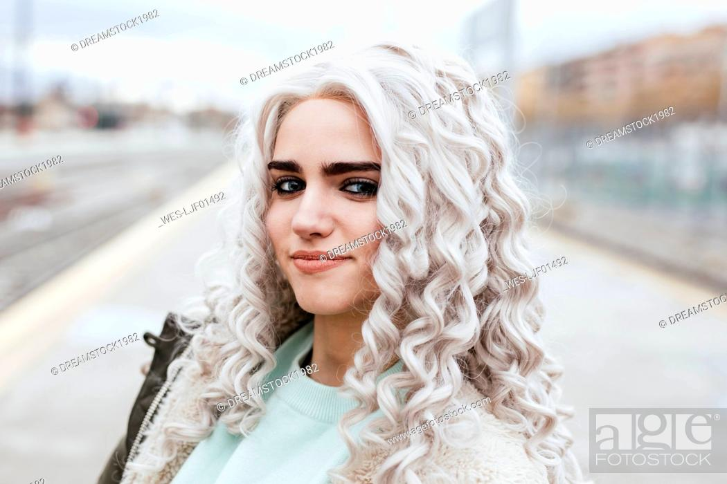Stock Photo: Portrait of smiling young woman on platform.