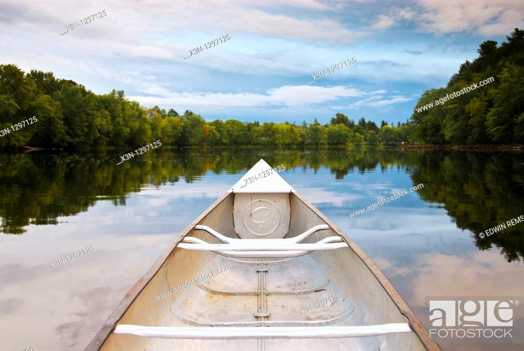 Stock Photo: Canoe on the water of Stillwater River, Orono.