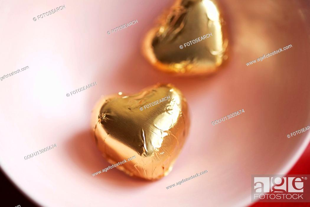Stock Photo: Two heart shaped candies in bowl (close-up, directly above).
