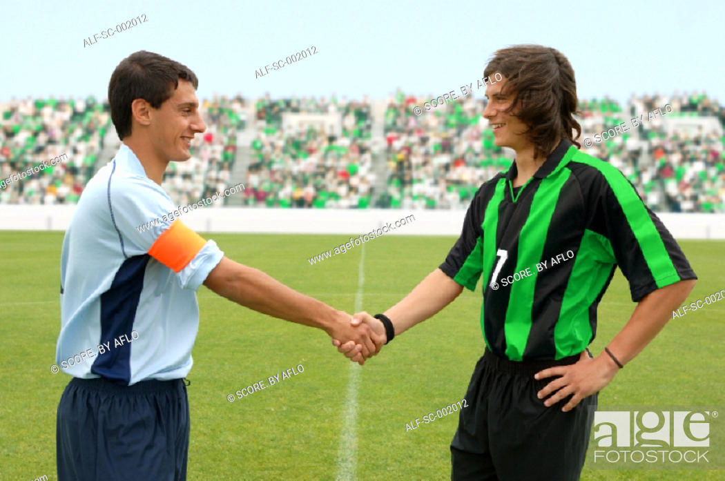 Stock Photo: Opposing captains shaking hands.
