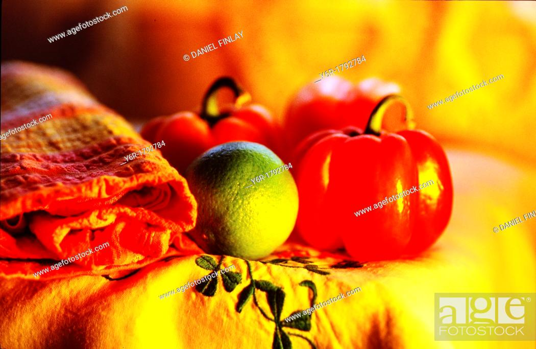 Stock Photo: Lime, pepper and knapkin on Irish linen tablecloth in front of a window in London.