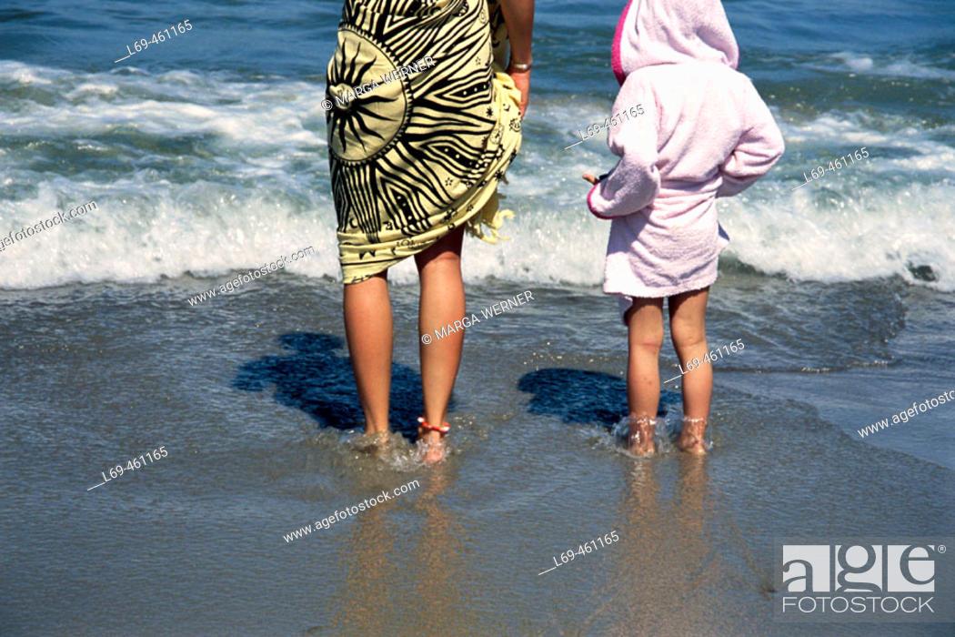 Stock Photo: Legs on the beach, Baltic Sea, Seaside resort Rostock-Warnemünde. Mecklenburg Western Pomerania. Germany.