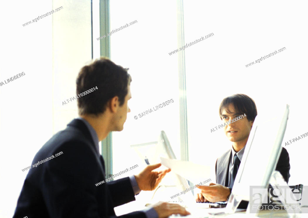 Stock Photo: Businessmen working at desk, head and shoulders.