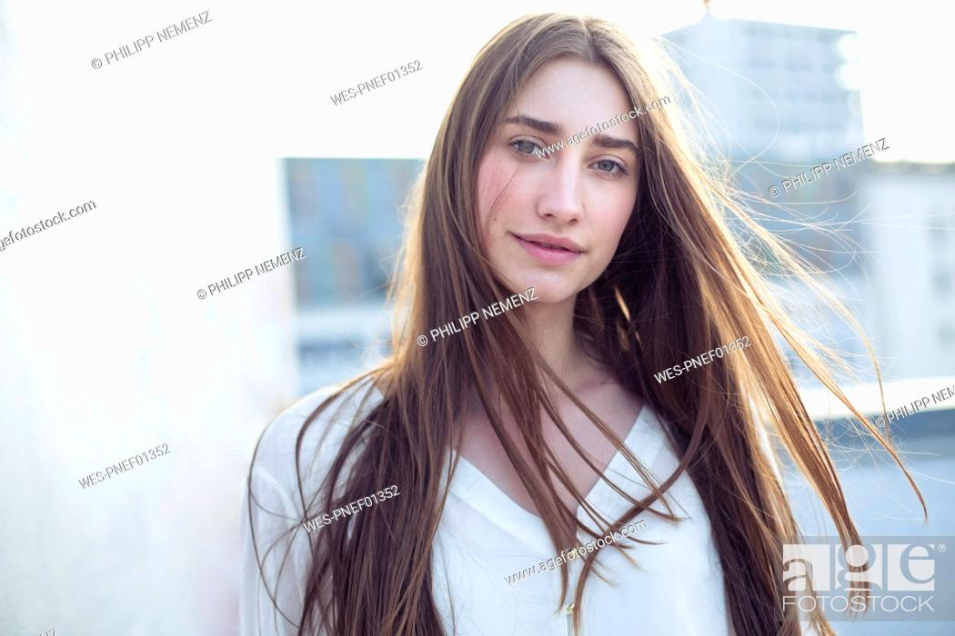 Portrait Of Smiling Young Woman With Windswept Hair Stock Photo Picture And Royalty Free Image Pic Wes Pnef01352 Agefotostock