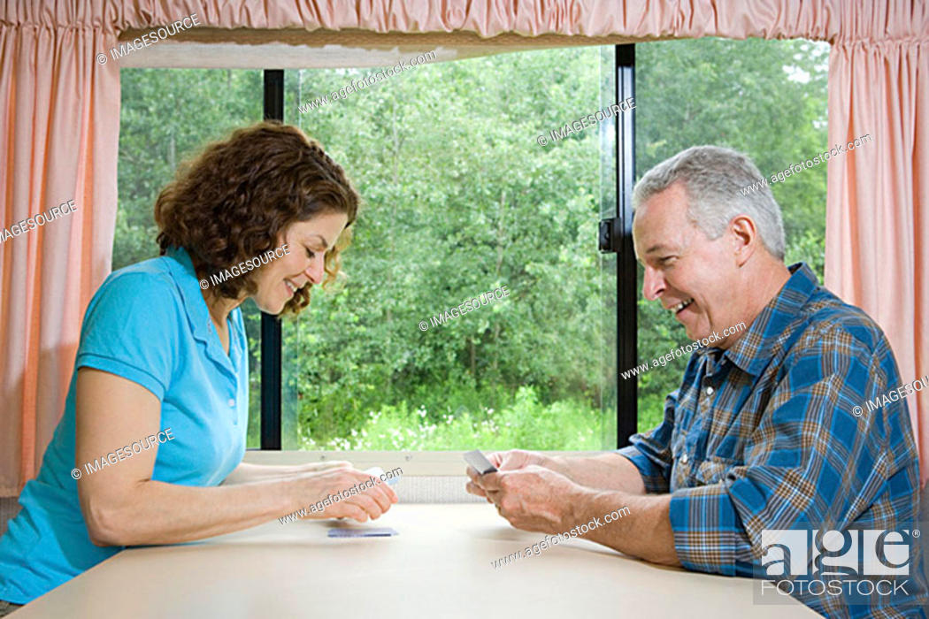 Stock Photo: Mature couple playing cards.