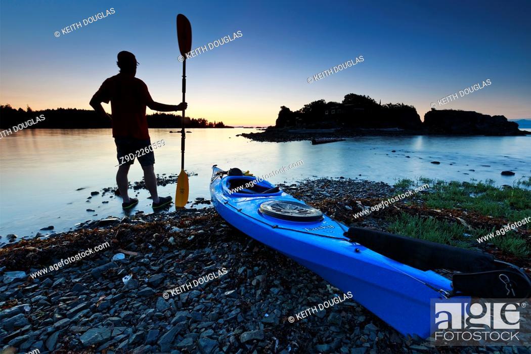 Stock Photo: Sea kayaker at sunset, Pipers Lagoon Park, Nanaimo, Vancouver Island, British Columbia.