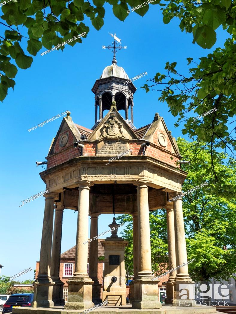 Stock Photo: The Fountain Water Pump in St James Square at Boroughbridge, Yorkshire, England.