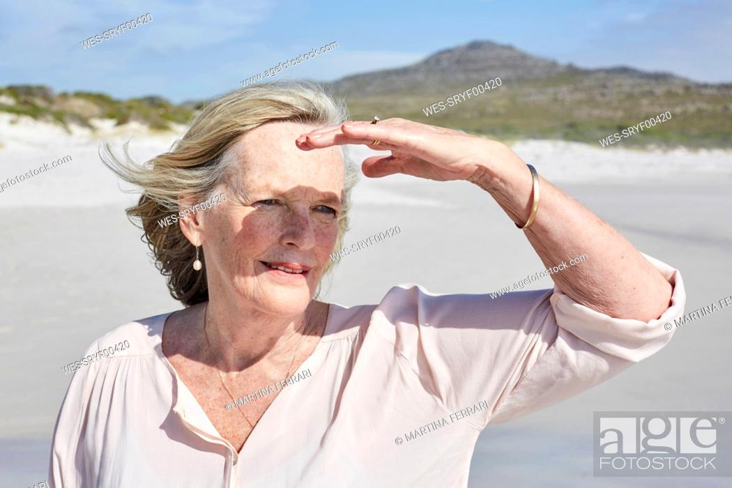Stock Photo: Portrait of a senior woman by the sea.