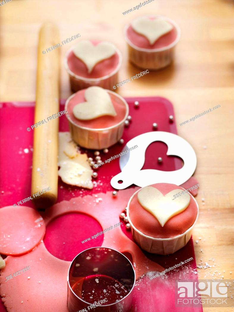 Stock Photo: Cupcakes decorated with almond paste hearts for mother's day.