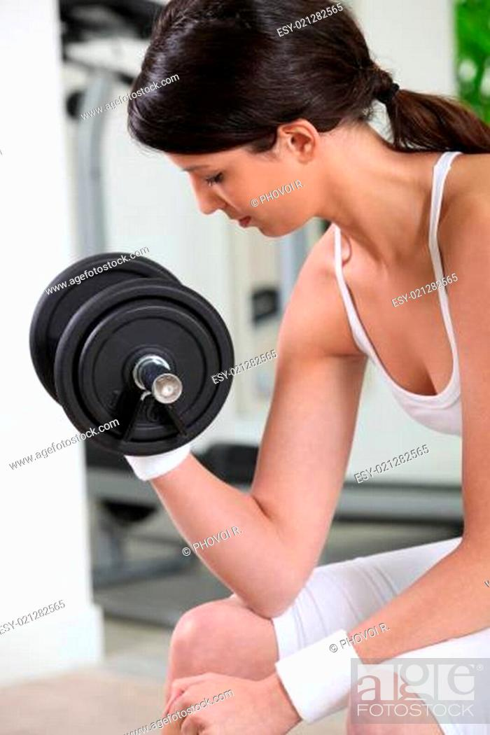 Stock Photo: Woman lifting a dumbbell.