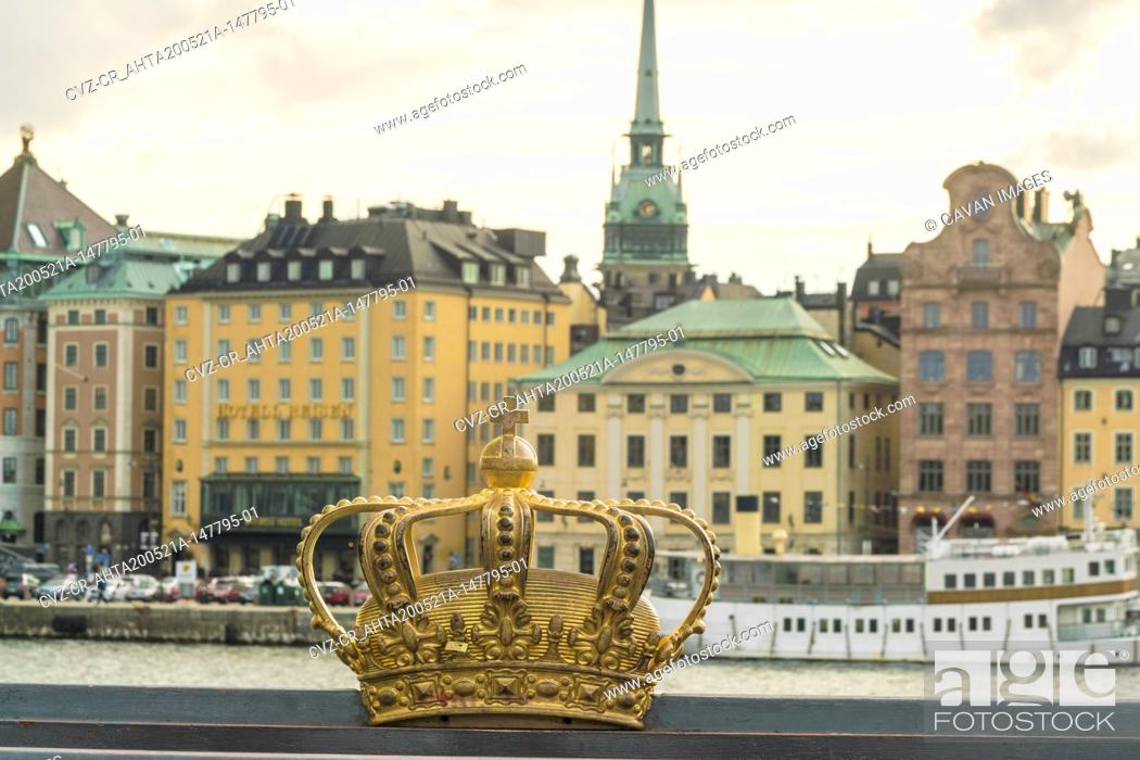 Stock Photo: Golden crown with view of Gamla Stan in the background.