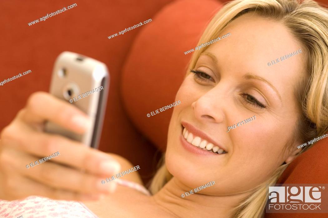 Stock Photo: Young woman using mobile phone.