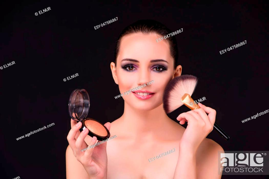 Stock Photo: Woman applying shadows in beauty concept.