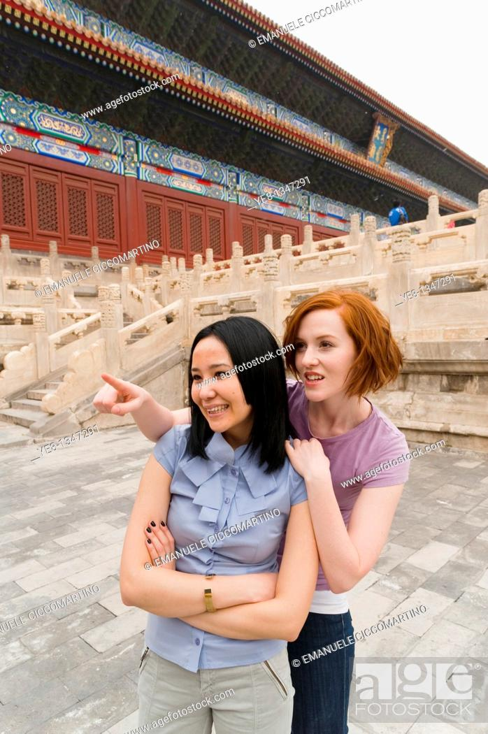 Stock Photo: Tourist pointing something out to her friend in The Forbidden City, Beijing, China, Asia  MR.