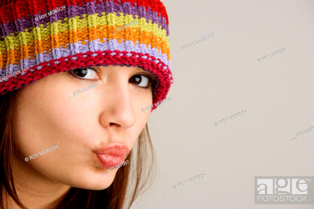 Stock Photo: Portrait of caucasian-hispanic woman in her twenties with cap.