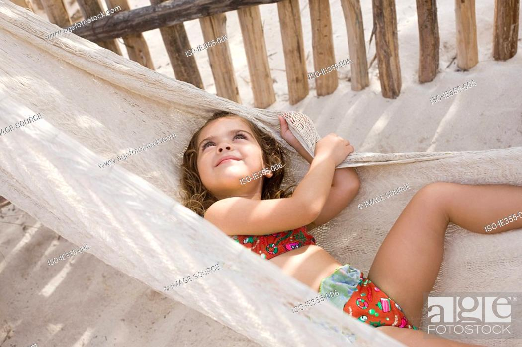 Stock Photo: A girl on a hammock.