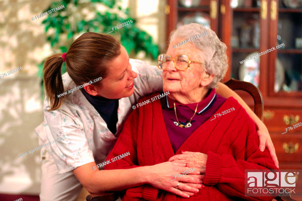 Stock Photo: Health care worker giving support to resident in nursing home.