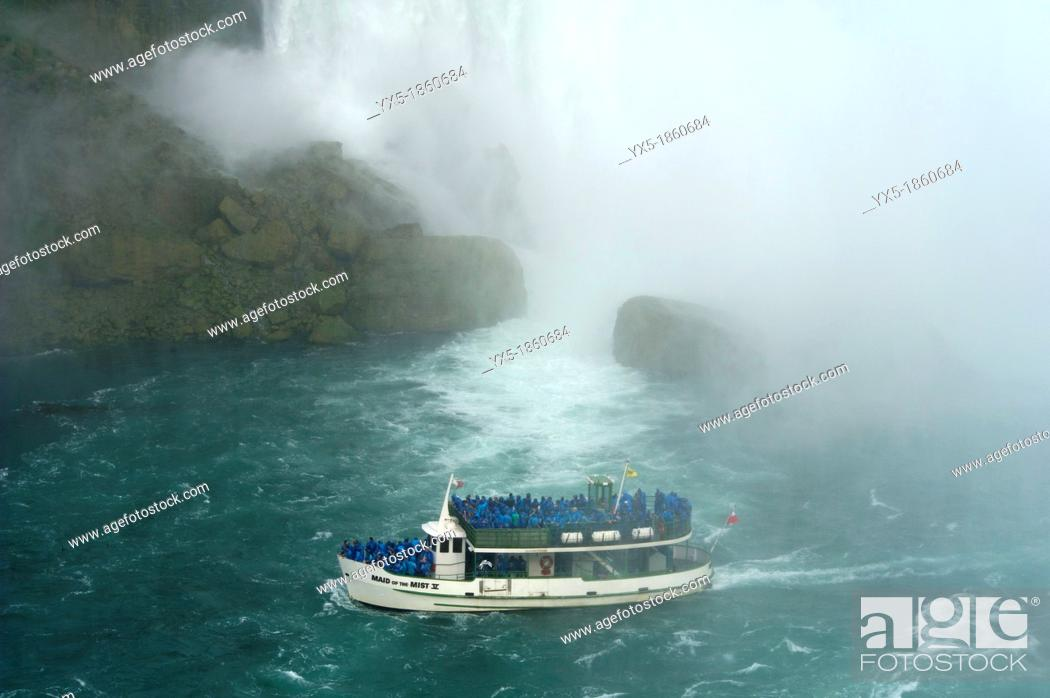 Stock Photo: Maid of the Mist boat carrying tourists at the bottom of Niagara Falls.