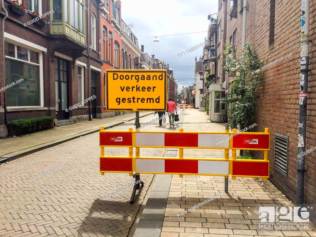 Stock Photo: Tilburg, Netherlands. Traffic sign blocking all traffic and pedestrians into a streete due to an event.