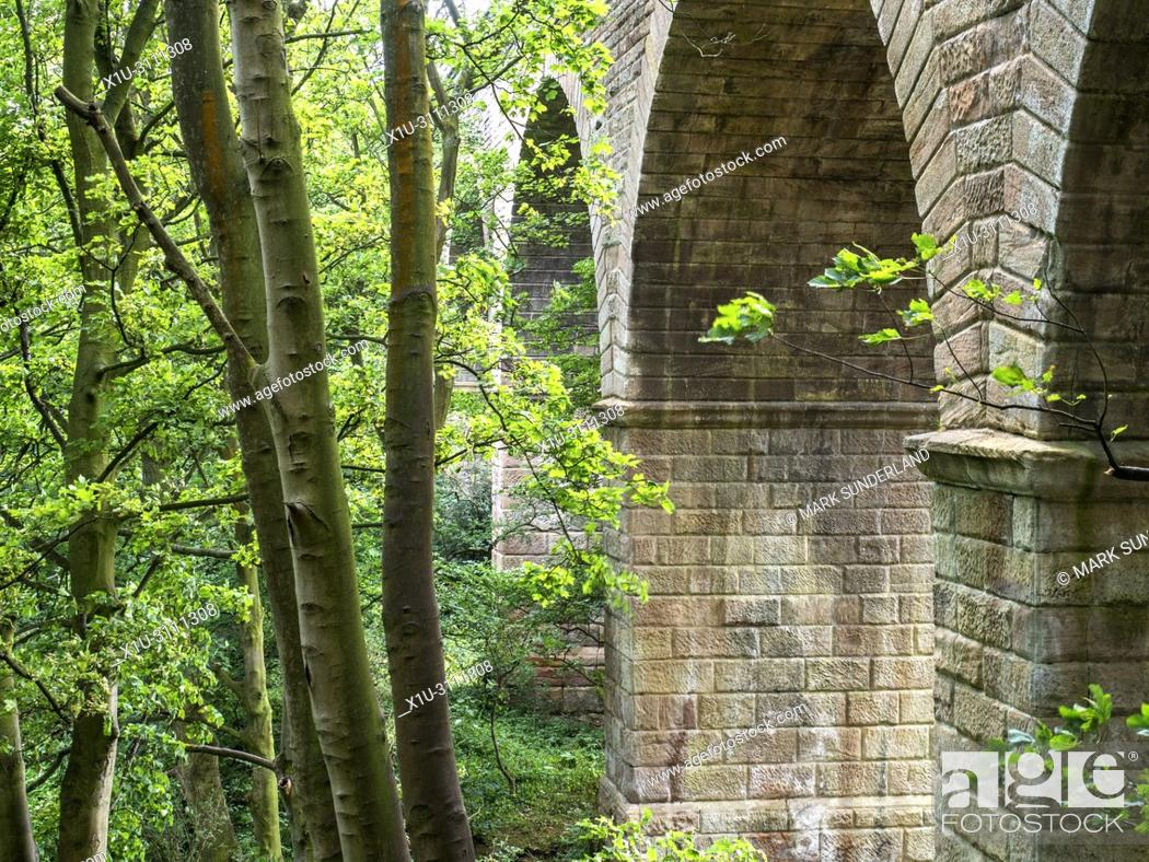 Stock Photo: Railway viaduct on the disused part of the old Leeds and Thirsk Railway in the Crimple Valley Harrogate North Yorkshire England.