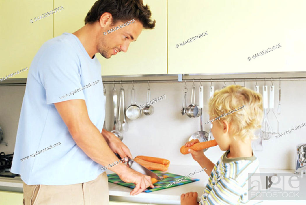 Stock Photo: Boy and father preparing carrots.