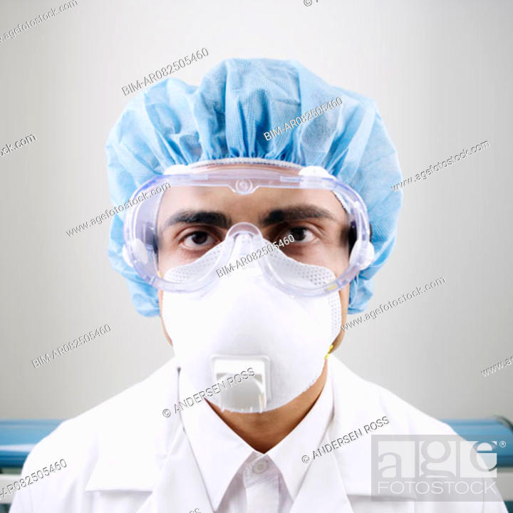 Stock Photo: Portrait of male technician in protective gear and face mask in lab.