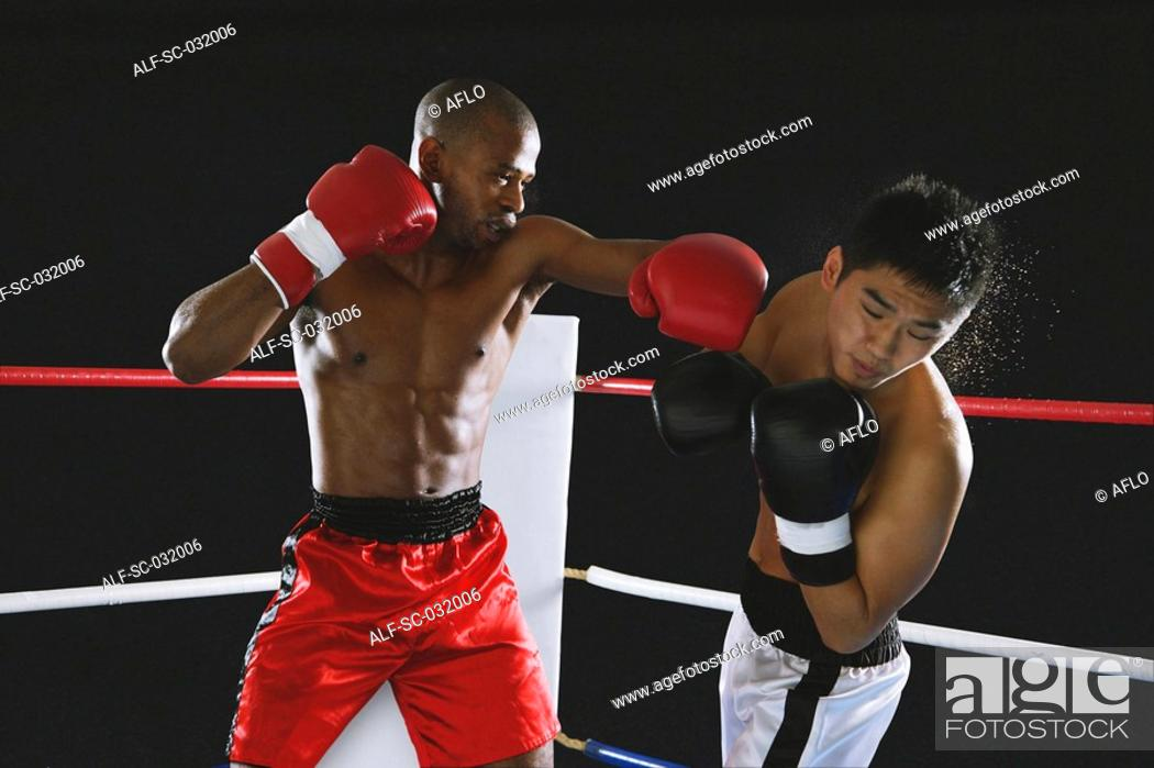Stock Photo: Boxers fighting in Boxing ring.
