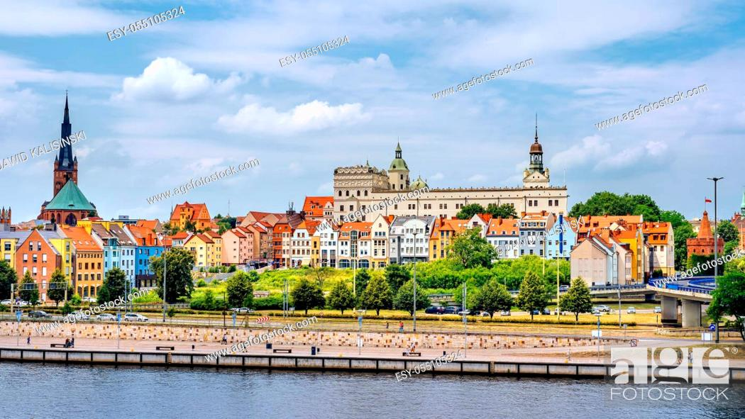 Stock Photo: People walking on Piastowski Boulevard. Old town, Castle of Pomeranian Dukes and Cathedral Basilica of St James the Apostle in background, Szczecin.