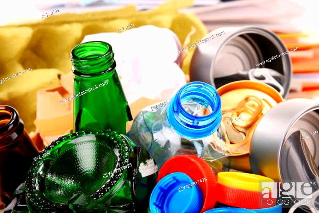 Stock Photo: Recyclable garbage consisting of glass, plastic, metal and paper isolated on white background.