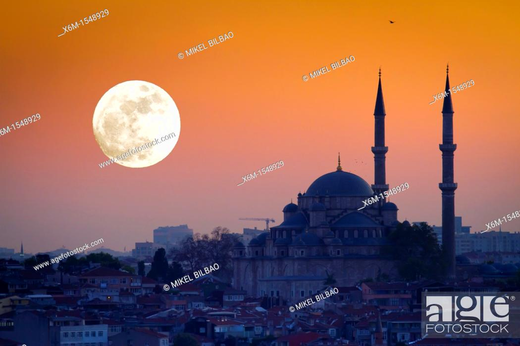 Stock Photo: Mosque silhouetee with moon at sunset Istanbul, Turkey.
