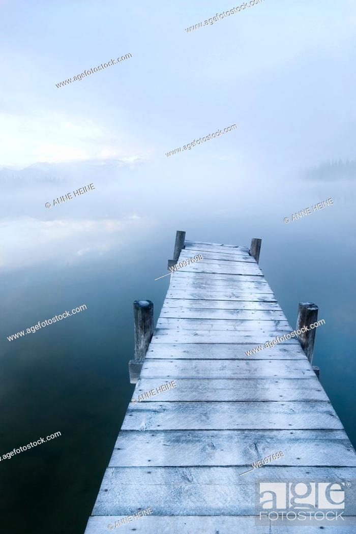 Stock Photo: catwalk leading onto lake, sad mood.