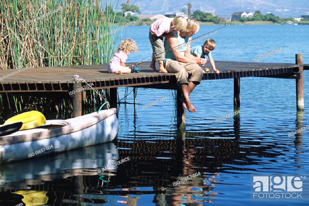 Stock Photo: Father and children fishing.
