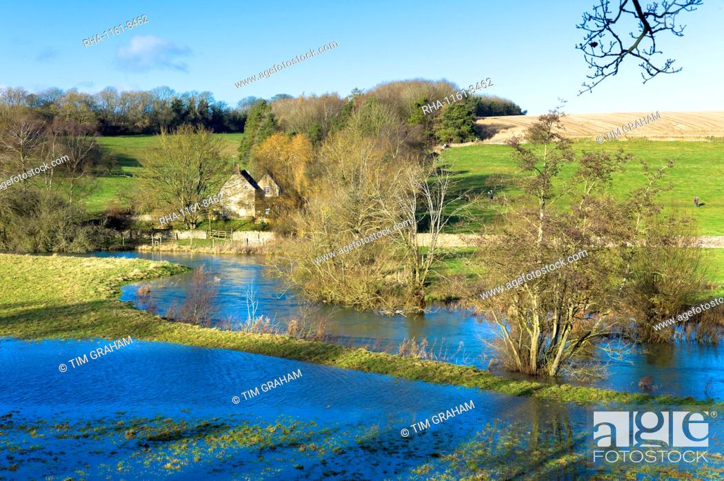 Stock Photo: Flooded fields as the River Windrush burst its banks after heavy rain near Burford in The Cotswolds, Oxfordshire, England, United Kingdom, Europe.