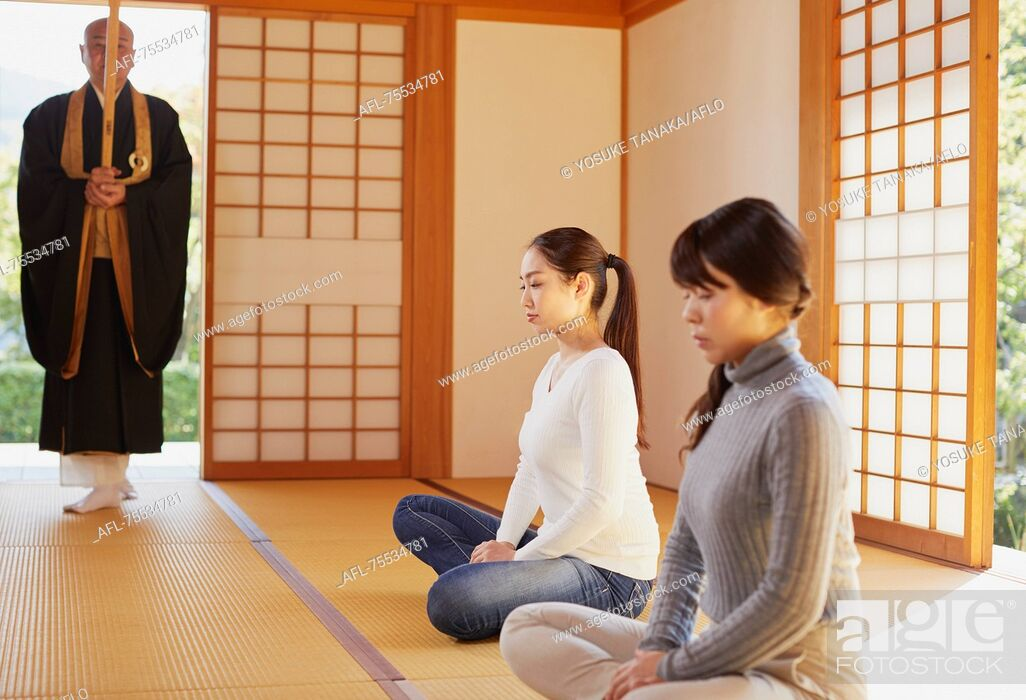 Stock Photo: Japanese priest preaching to women at a temple.