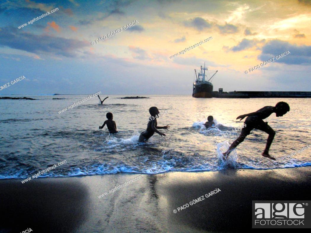 Stock Photo: Children playing on beach by the port of Ipikel. Tanna, Vanuatu.
